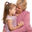 The elderly woman with the grand daughter - Stock Photo