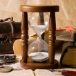 Hourglass and the book - vintage - Stock Photo