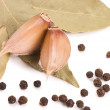 Black Peppercorns with garlic and a bay leaf - Stock Photo
