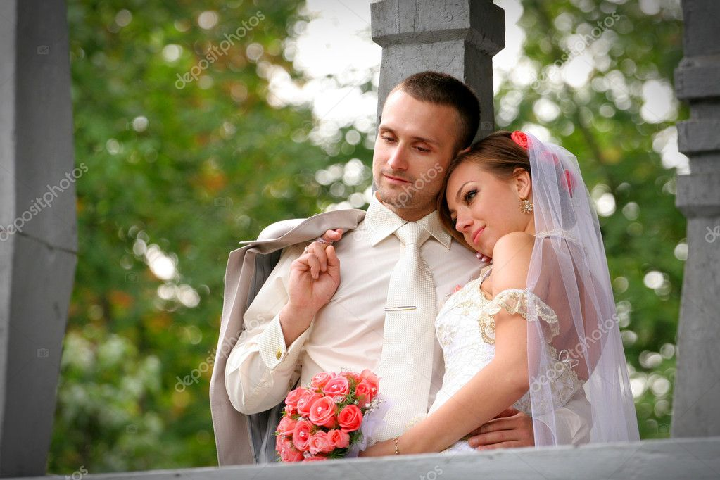 The bride has put a head on a shoulder to the groom — Stock Photo #5275140