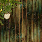 Card for the holiday with branches and clock on the wooden backg — Stock Photo