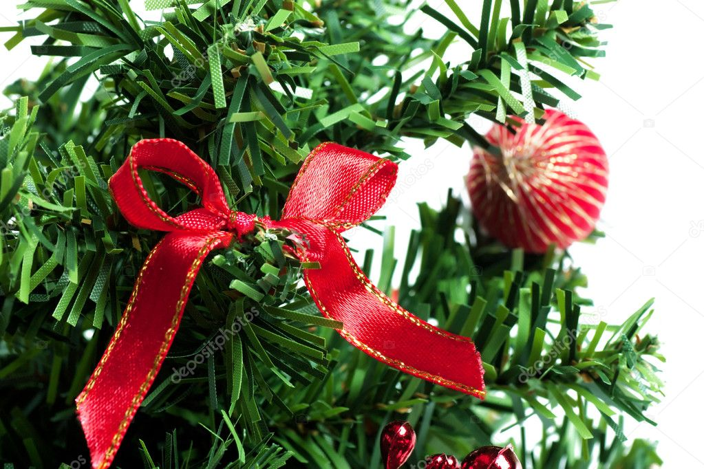 Christmas decorations on a branch of manufactured christmas tree — Stock Photo #4441211