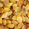 Golden yellow raisins background — Stock Photo