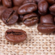 Coffee beans on sack — Stock Photo