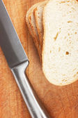Knife and bread — Stock Photo