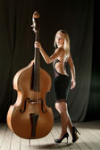 The girl and a contrabass — Stock Photo