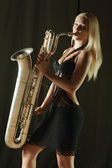 The girl and a saxophone — Stock Photo