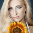 Stock Photo: Beautiful girl with sunflower