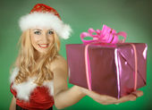 Winter woman holding gift — Stock Photo