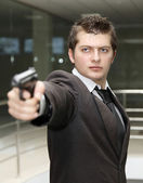 Business man with Gun — Stock Photo