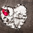 Stock Photo: Metal armored and red glass hearts