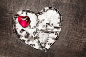 Metal armored and red glass hearts — Stock Photo