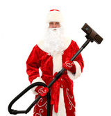 Santa Claus with a vacuum cleaner — Stock Photo