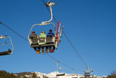 Three men on a chair lift in Flims Switzerland — Stock Photo