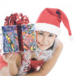 Stock Photo: Beautiful christmas womin santhat holding gift