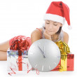 Beautiful Santa girl with clock waiting midnight — Stock Photo