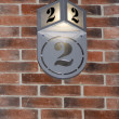 Royalty-Free Stock Photo: The number two (2) on a brick wall.