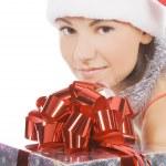 Santa woman showing gift wearing Santa hat. — Stock Photo #4247489