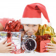 Beautiful Santa girl with clock showing midnight — Stock Photo #4247492