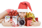 Beautiful Santa girl with clock showing midnight — Stock Photo