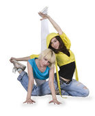Teenager girls dancing breakdance in action — Stock Photo