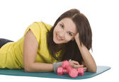 Attractive young female with fitness dumbbells in sport center — Stock Photo