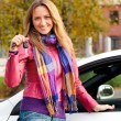 The happy woman showing the key of her new car — Stock Photo #3944028
