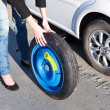 Stock Photo: Womchanging wheel