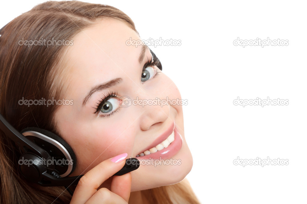Pretty caucasian woman with headset smiling during a telephone conversation. — Stock Photo #4078826