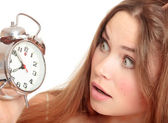 Unhappy girl waking up too late — Stock Photo