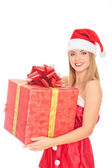 Cheerful santa helper girl with big gift box — Stock Photo