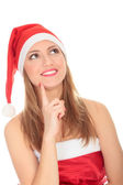 Female Santa looking up over a white background — Stock Photo