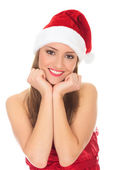 Picture of pretty christmas girl in red dress and santa hat, smi — Stock Photo