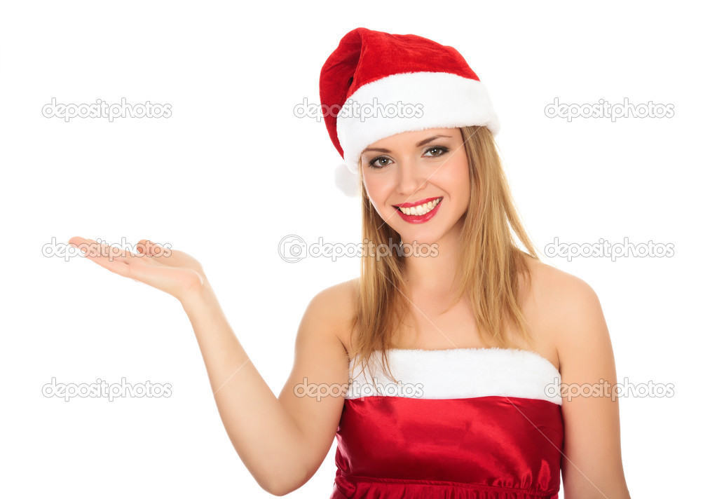 Pretty girl wearing red Christmas hat, holding a hand palm up. Isolated over a white background.  — Stock Photo #4319630
