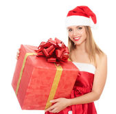 Cheerful santa helper girl with big gift box — Stockfoto