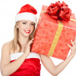 Cheerful santa helper girl with big gift box. — Stock Photo