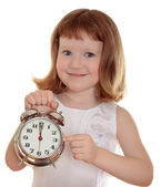 Portrait of little girl holding alarm clock, isolated over white — Stock Photo