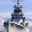 Battleship docked at a harbor - Stock Photo