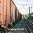 Railway tracks with freight train wagons - Stock Photo