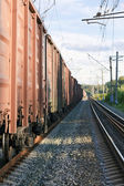 Railway tracks with freight train wagons — Stok fotoğraf