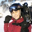 Stock Photo: Young adult female snowboarder