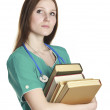 Female nurse in the green uniform with books — Stock Photo #4751840