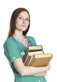 Female nurse in the green uniform with books — Stock Photo
