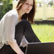 Pretty young woman with a laptop at park — Stock Photo #4762637