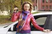 Beautiful young happy woman with car keys — Stock Photo