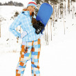 Woman with snowboard — Stock Photo #4869047