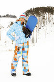 Woman with snowboard — Stockfoto