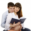 Royalty-Free Stock Photo: Pregnant woman and her husband reading a book