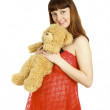 Pregnant woman holding teddy bear on her belly — Stock Photo