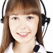 Beautiful smiling young asian woman wearing a headset — Stock Photo